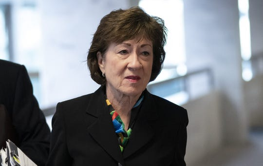 Then Susan Collins, R-Maine, arrives at a meeting with a select group of Senate Republicans, Senate Democrats and Trump administrators in the Hart Senate office building on Capitol Hill March 20, 2020 in Washington.