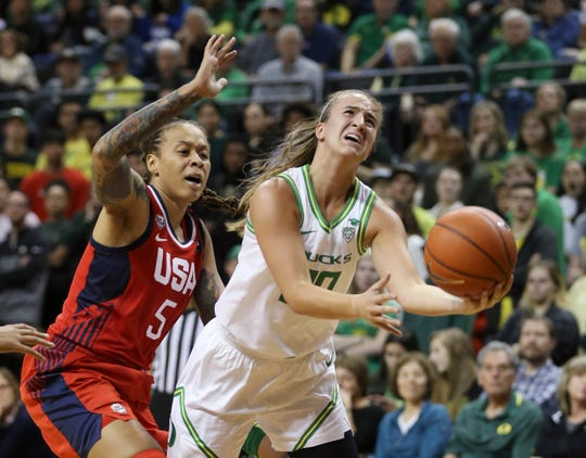 Sabrina Ionescu, right, goes up for a shot ahead of U.S. national team guard Seimone Augustus during an exhibition game in Eugene, Oregon on Nov. 9, 2019.