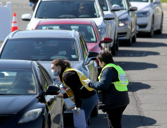 People are cheched in at the Somerset/Hunterdon County COVID-19 Drive-Thru Testing Clinic at Raritan Valley Community College in Branchburg, NJ, Thursday, April 16, 2020.