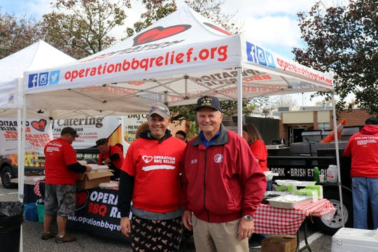 """David Keith, New Jersey area coordinator for Operation BBQ Relief (left), and Toms River Mayor Maurice B. """"Mo"""" Hill Jr. during the charity's visit to Toms River last year."""