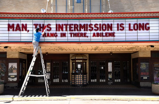 Without events to advertise, the Paramount Theatre marquee has become a community message center.