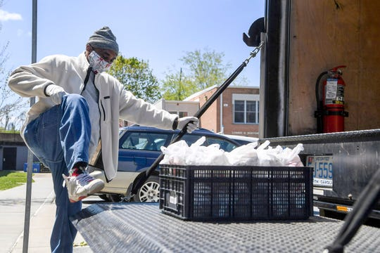 Cedric Tobe-Holloman loads 50 meals onto a truck at the Southside Kitchen in Asheville April 16, 2020.