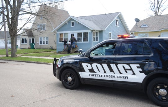 Five Battle Creek police officers passed Ian Lockmiller and his family on Thursday to wish the boy a happy 11th birthday.  Trace Christenson/The Enquirer