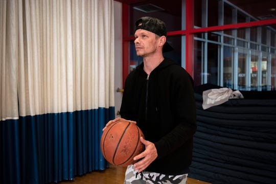 Matt Ramsey shoots hoops at Full Blast's indoor recreational center on Wednesday, April 15, 2020 in Battle Creek, Mich. Battle Creek's S.H.A.R.E. Center has converted Full Blast into temporary shelter for homeless citizens during the COVID-19 pandemic.