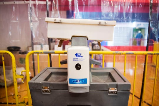 A hand sanitizing station is pictured at Full Blast's indoor recreational center on Wednesday, April 15, 2020 in Battle Creek, Mich. Battle Creek's S.H.A.R.E. Center has converted Full Blast into temporary shelter for homeless citizens during the COVID-19 pandemic.