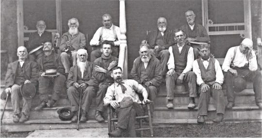 Inmates at the men's dormitory in about 1890.