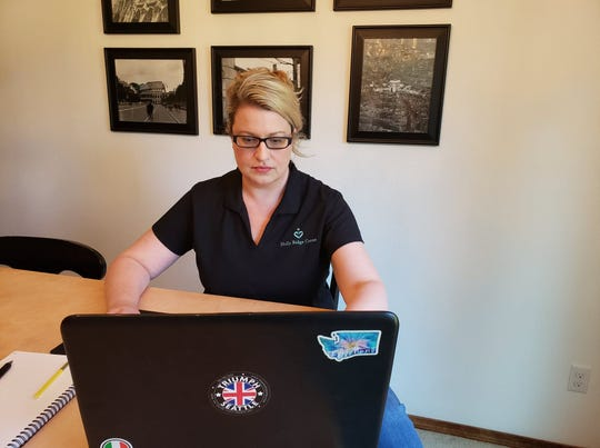 Holly Ridge executive director Dedra Miller works from home. Therapists and educators at the nonprofit neurodevelopment center have had to transition to working remotely with clients during the COVID-19 outbreak.