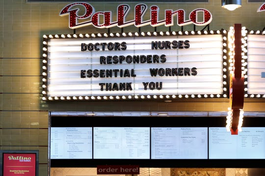 A still-open restaurant gives a thanks to medical personnel and essential workers from an overhead sign at Seattle-Tacoma International Airport Wednesday, April 15, 2020.