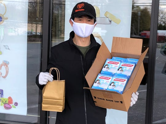 Tan Tran, co-owner of Shannon's Fine Jewelry in Essex Junction, delivers cloth masks to local businesses on April 16, 2020.
