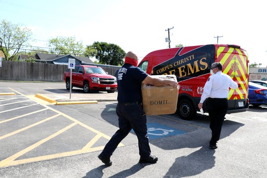 Corpus Christi Fire Department engineer Art Caceres, left, and Fire Chief Robert Rocha load masks donated to the fire department and police department by the Texas Bridge Credit Union on Thursday, April 16, 2020.