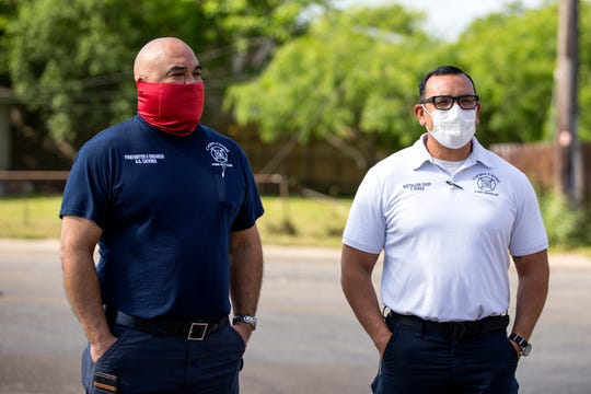 Corpus Christi Fire Department engineer Art Caceres, left, and Battalion Chief Tony Perez attend a donation of masks to the department and police department at the Texas Bridge Credit Union on Thursday, April 16, 2020.