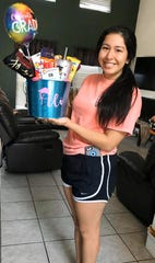"Tuloso-Midway High School senior Ali Gonzalez is pictured with gifts from Ashley Calderon. Calderon created a Facebook group where residents can ""adopt"" seniors and send them gifts."