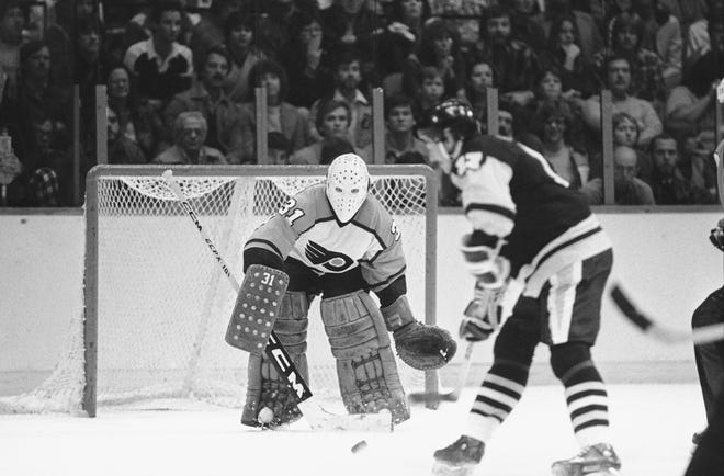 Flyers' goalie Pelle Lindbergh, seen here facing Pittsburgh Penguins' right wing Rick Kehoe in 1982, played 157 games for the Flyers across five seasons.
