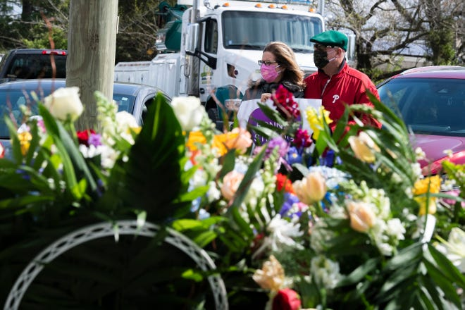 Family and community members line Route 40 during a funeral procession for Ronnie Dandrea, 57, Thursday, April 16, 2020 in Landisville, N.J. Funeral service for Dandrea, who passed away from pancreatic cancer, was limited in number due to COVID-19.