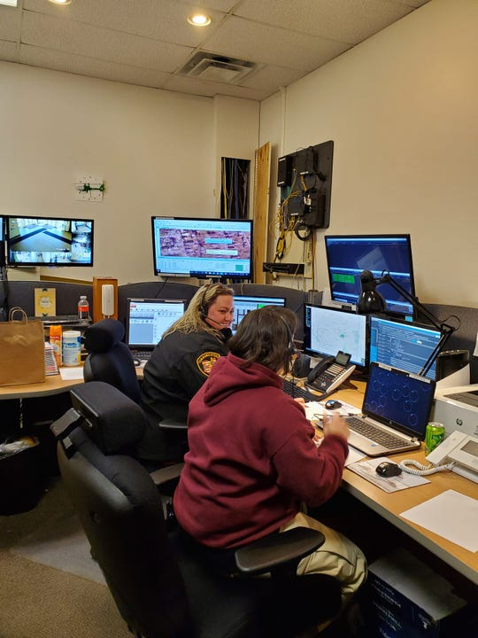 Dispatcher Maleena Brown and Supervisor Angie Stewart handle dispatch calls in April 2020.