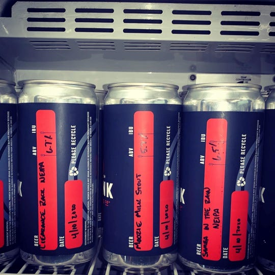 The Root Cellar's stocked crowler fridge.