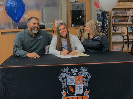 Ryle High School senior Kai Dickerson, with her parents, Bob and Pepper, signed to play softball at Thomas More University.