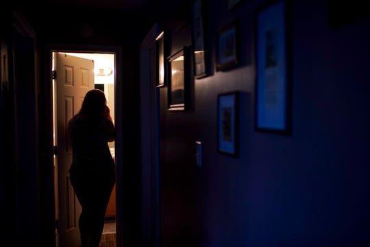 Teala Goff stands in the doorway of the bathroom, chatting with her daughter Raegyn about dinner at the Goff household in Oak Grove, KY., on Tuesday, April 14, 2020.