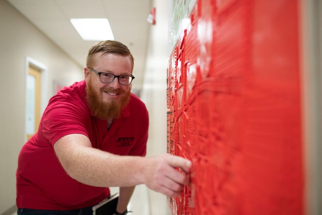 Michael Hunter points to a feature on the tactile map he designed and 3D-printed for APSU's GIS Center.