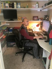 Jiang Li works in his closet-office.
