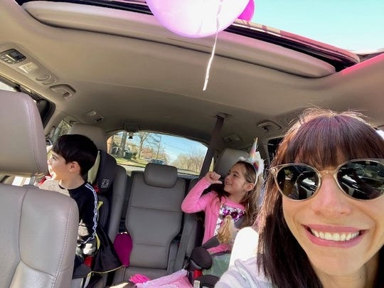 Rebecca Peckman drove her twins past several of their friends homes for their drive-by birthday party.