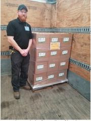 IPI staff technician Garrett Landuyt with the first pallet of hand sanitizer loaded for shipment.