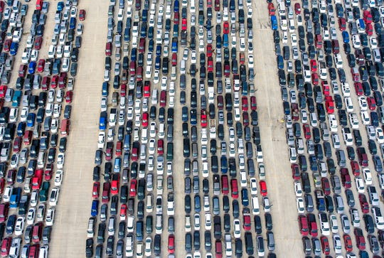 In this April 9, 2020, file photo, people wait in their cars at Traders Village for the San Antonio Food Bank to begin food distribution.