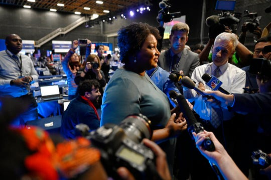 In this Nov. 20, 2019, file photo former Democratic candidate for Georgia Governor, Stacey Abrams speaks during an interview ahead of a presumptive Democratic presidential primary debate in Atlanta.