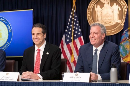 FILE - In this March 2, 2020 file photo New York Gov. Andrew Cuomo, left, and Mayor Bill de Blasio discuss the state and city's preparedness for the spread of coronavirus at a news conference in New York.