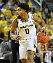David DeJulius appeared in 56 games and averaged 4.1 points and 0.9 assists during his two seasons with the Wolverines.