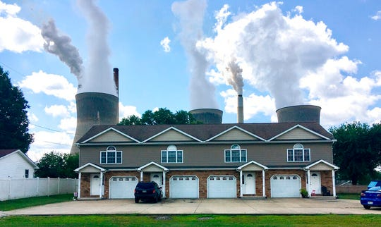In this Aug. 23, 2018, file photo, a coal-fired plant in Winfield, W.Va, is seen from an apartment complex in the town of Poca across the Kanawha River. The Trump administration is gutting an Obama-era rule that compelled coal plants to cut back emissions of mercury and other human health hazards, limiting future regulation of air pollutants by petroleum and coal plants.