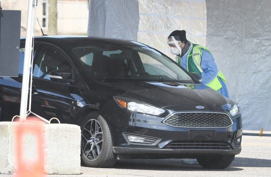 Residents who had prearranged appointments were processed while never leaving their vehicles and sent on their way within a couple of minutes without any problems, according to Oakland County Executive David Coulter.