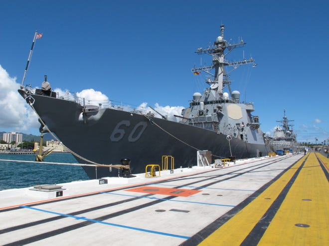 FILE - Guided missile destroyer USS Paul Hamilton is docked at Pearl Harbor, Hawaii on Thursday, Aug. 8, 2013.