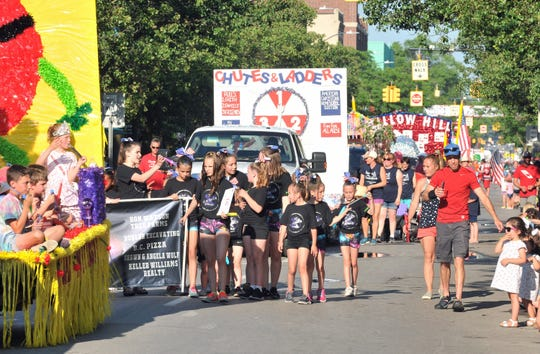 The 93rd National Cherry Festival Junior Royale Parade winds through downtown Traverse City last year.