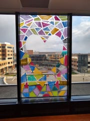 A kaleidoscope of painted colors with a heart shape changes the view from one hospital room in Lansing during the COVID-19 crisis.