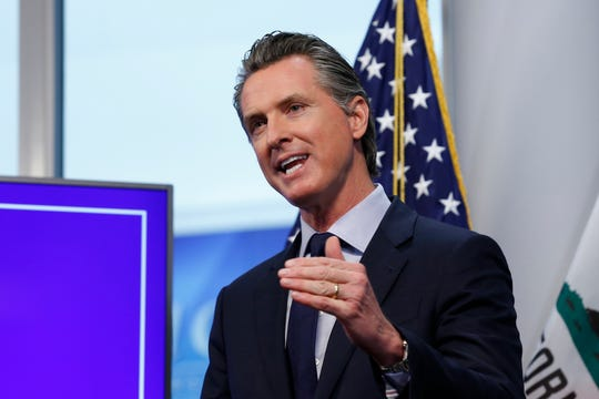 FILE - In this file photo taken Tuesday April 14, 2020, California Gov. Gavin Newsom discusses an outline for what it will take to lift coronavirus restrictions during a news conference at the Governor's Office of Emergency Services in Rancho Cordova, Calif.