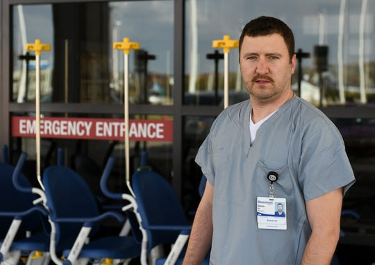 Steve Homick of Windsor is a registered nurse at Beaumont Hospital-Royal Oak emergency room in Royal Oak, Mich. on April 16, 2020.  Homick is among about 1,600 Canadian nurses fighting the pandemic at Detroit hospitals, but some Canadian health officials are worried they could spread the disease in Canada and want to restrict their movements across the border.