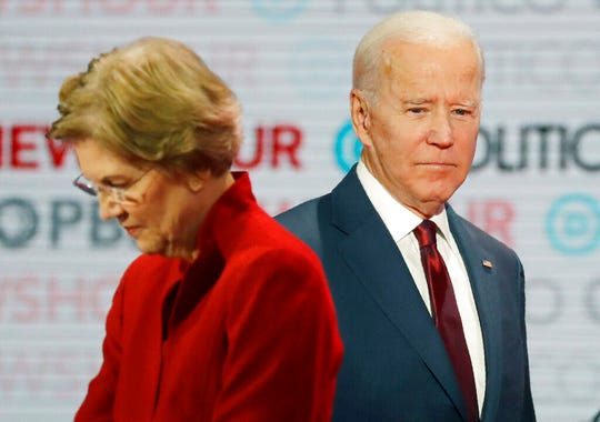 In this Dec. 19, 2019, file photo presumptive Democratic presidential candidates Sen. Elizabeth Warren, D-Mass., left, and former Vice President Joe Biden stand on stage during a break at a presumptive Democratic presidential primary debate in Los Angeles.