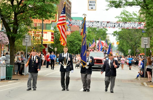 Spectators line the streets of downtown Traverse City last July for the National Cherry Festival Junior Royale Parade.
