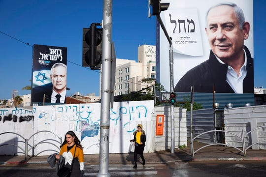 Campaign billboards showing Israeli Prime Minister Benjamin Netanyahu, right, and Benny Gantz, in Bnei Brak, Israel.