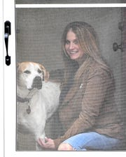 Julia Rosen and her dog Ginger at her home in Birmingham, Michigan on April 16, 2020.