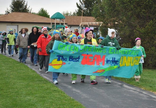 A  group of students and staff from Green Springs Elementary participates in a previous NAMI Walk at Conner Park in Ballville Township. The mental health organization plans to hold a virtual walk/run in 2020.