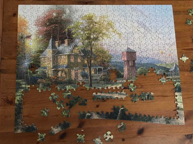 Puzzling is a good family activity during lockdown because of COVID-19. Just don't be that guy who swoops in to put down the last piece after contributing little or nothing to the cause.