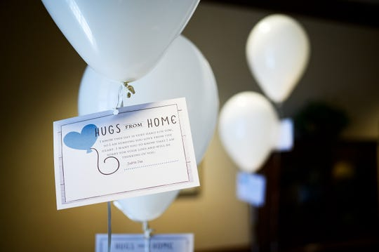An example of a message card balloon at Thomas McAfee Funeral Home Northwest Chapel Thursday, April 16, 2020.