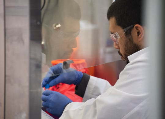 Omar Salas prepares samples from COVID-19 tests at Precision Genetics in Greenville Wednesday, April 15, 2020. Precision Genetics is working with Prisma Health to complete testing for patients.
