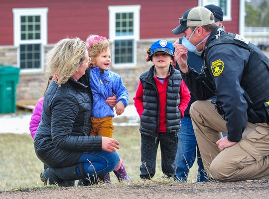 Abbigale McRady, age 3, celebrates her third birthday with a parade by officers from the Cascade County Sherriff's Office and a visit with Deputy John Nolan on Thursday, April 16, 2020.