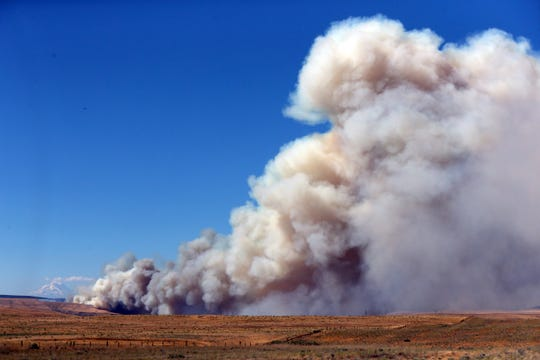 FILE - In this Wednesday, July 18, 2018 file photo, a fast-moving fire continues to burn across Wasco County southeast of The Dalles, Ore., with drought conditions in many areas of the region.  two-decade-long dry spell that has parched much of the western United States is turning into one of the deepest megadroughts in the region in more than 1,200 years, and about half of this historic drought can be blamed on man-made global warming, according to a study released Thursday, April 16, 2020 in the journal Science. (Mark Graves/The Oregonian via AP)