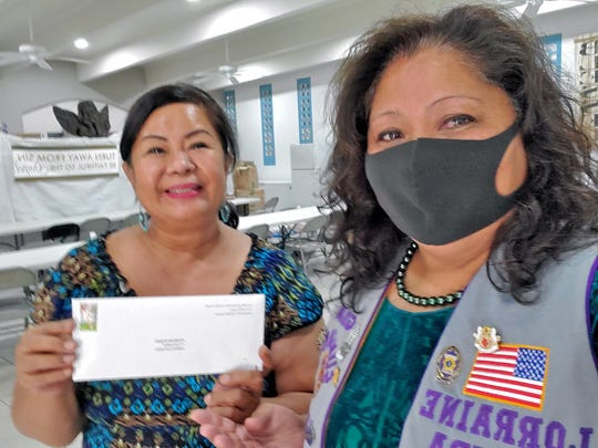 Doris Royal receives the donation from Lorraine Rivera of the Guam Sunshine Lions Club. Hunger relief is one of the focus areas of service provided by Lions clubs throughout the world.