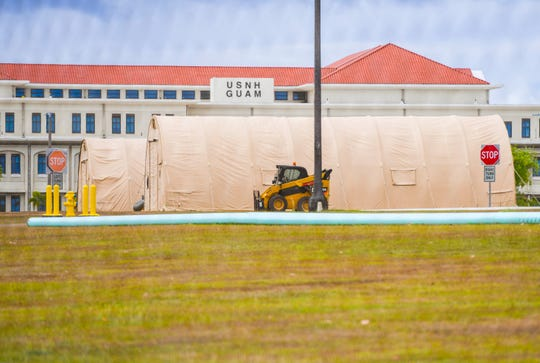 Quonset-style shelters can be seen erected at the U.S.Naval Hospital Guam installation in Agana Heights on Thursday, April 16, 2020. An Expeditionary Medical Support System is being constructed by U.S. Air Force Engineers, assigned to the 554th RED HORSE Squadron, at the military facility in response to the coronavirus pandemic.