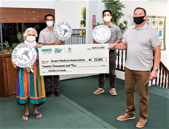Paul A. Calvo, far right, president and CEO of Calvo's Insurance Underwriters, presents a $20,000 check to the Guam Medical Association on April 14. From left, Pram Sullivan, GMA executive director; Dr. Peter Lombard; volunteer Kai Akimoto and Calvo.